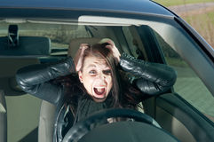 Woman screaming in the car Royalty Free Stock Photo