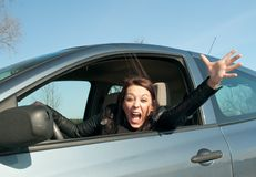 Woman screaming in the car. Angry young woman screaming in the car Royalty Free Stock Photo