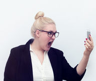 Woman screaming at cell phone on white Stock Photography