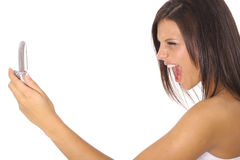 Woman screaming at cellphone Stock Photography