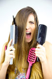 Woman screaming desperate about messy long hair. Unhappy woman screaming about messy hair Stock Photo