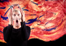 Woman screaming with distorted face. Abstract woman screaming with distorted face and abstract painted background Royalty Free Stock Images