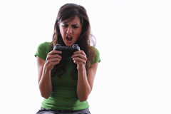 Woman screaming at game controller Stock Photo