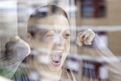 Woman screaming glass Stock Photography