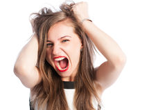 Woman screaming and grabbing her hair. Business woman screaming and grabbing her natural hair Stock Images