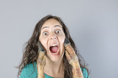 Woman screaming with ham leg in her face. Stock Photo