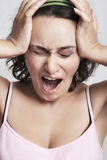 Woman screaming from headache Stock Image