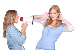 Woman screaming at her friend Stock Image