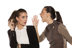 Woman screaming at her friend Stock Photography