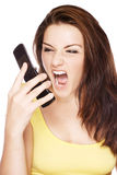 Woman screaming at her phone Stock Photo