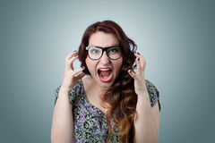 Woman screaming in horror, grimace portrait Royalty Free Stock Photos