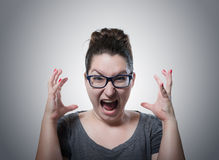 Woman screaming in horror, grimace portrait Royalty Free Stock Images