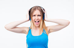 Woman screaming while listen music on headphones Royalty Free Stock Photography