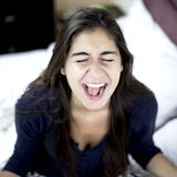 Woman screaming loud for desperation. Sad woman shouting in bed desperate Stock Photo