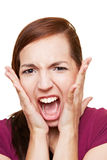 Woman screaming loudly Stock Images