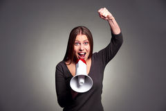 Woman screaming in loudspeaker Stock Photo