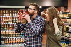 Woman screaming at man. Woman screaming at men which holding keg of beer Stock Photos