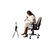 Woman screaming at man on the stepladder Stock Photo