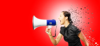 Woman screaming. On a megaphon, torn in the form of a puzzle on a red background Stock Photos