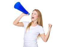 Woman screaming on a megaphone Royalty Free Stock Images