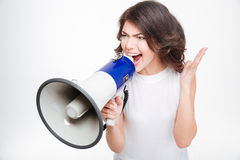 Woman screaming into megaphone Royalty Free Stock Images