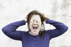 Woman screaming nervously Stock Images