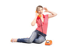 Woman screaming into the old style phone. On white background Royalty Free Stock Image