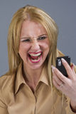 Woman screaming at phone Stock Image