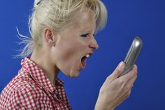 Woman screaming in the phone Stock Photos