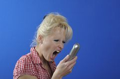 Woman screaming in the phone Stock Image