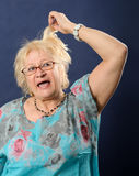 Woman screaming and pulling her hair. Stock Photography