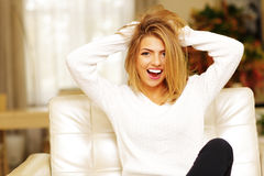 Woman screaming and pulling her hair. Young cheerful woman screaming and pulling her hair Stock Photo