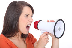 Woman screaming in speakerphone Royalty Free Stock Photography