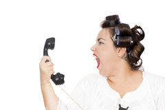Woman screaming at telephone. Isolated on white background Stock Images