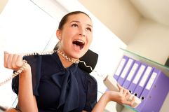Woman screaming in telephone receiver Stock Images