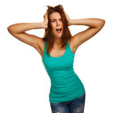 Woman screaming wild hair her mouth prislanila. Woman screaming wild hair opened her mouth prislanila hands to his head isolated on white background Stock Images