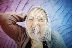 Woman screams and anguish. Girl trapped in mesh head, anguish stock photos