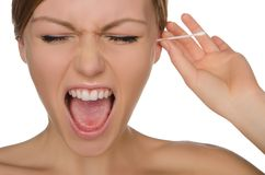 Woman screams and cleans ears with cotton sticks stock images
