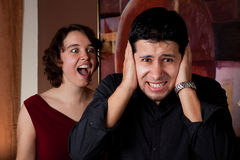 Woman screams at man. Man gets an earful from an annoyed lady Royalty Free Stock Image