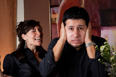 Woman screams at man. Man gets an earful from an annoyed lady Royalty Free Stock Images