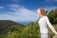Woman screams in the mountains Stock Photos
