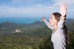 Woman screams in the mountains Royalty Free Stock Image