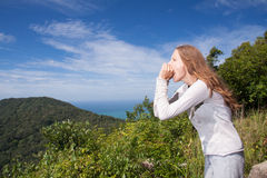 Woman screams in the mountains Stock Photo