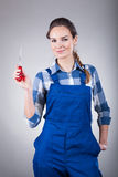 Woman with a screwdriver Royalty Free Stock Images