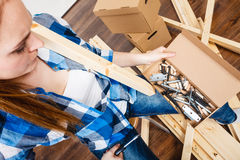 Woman with screwdriver and nails. DIY. Stock Image