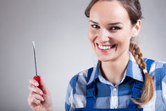 Woman with a screwdriver. Smiling, beautiful woman with a screwdriver, horizontal Stock Photos