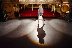 Woman With Script Rehearsing On Stage Royalty Free Stock Image