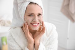 Woman with scrub on face. In bathroom Stock Images