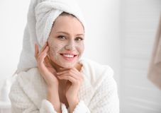 Woman with scrub on face. In bathroom Royalty Free Stock Photography