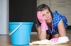 Woman scrubbing the floor Stock Image